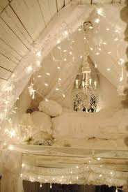 hang string lights to make twinkling draperies and turn your bedroom into a princess layer bedroom lighting ideas ideas