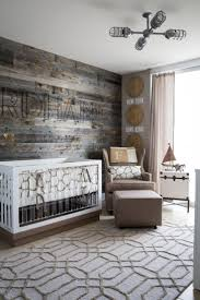 this subtle travel themed nursery features a driftwood wall fused with modern details like an baby furniture rustic entertaining modern baby