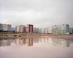 motherland simon roberts apartment blocks reflected in water sakhalin island far east russia 2004