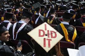 just over half of all college students actually graduate report image graduating student has i did it written on her mortar board during