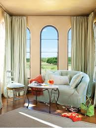 country living room ci allure: bright and airy sitting room with light blue sofa and curtains