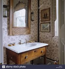 washstand bathroom pine: marble topped washstand in bathroom of english country house