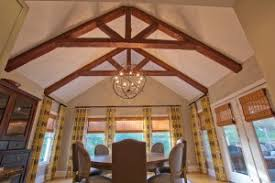 dining room remodeled with standard king truss made with custom timber beams and orbital chandelier beams lighting