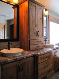 country themed reclaimed wood bathroom storage: rustic bathroom double vanity ideas rustic alder cabinetry highlights the double vanities in sam and
