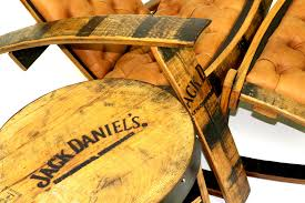 tufted leather whiskey barrel lounge chair and matching ottoman with an authentic end table authentic jim beam whiskey barrel table