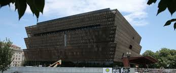 national museum of african american history and culture what to photo tourists walk past the smithsonian museum of african american history and culture that is