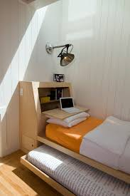 bole inspiration for a scandinavian guest bedroom remodel in san francisco with white walls and light bed for office