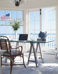 bright office room at the waterfront with chair table also lamp plus floors in white color so will bring shades of the beach that could make you feel cozy bright office