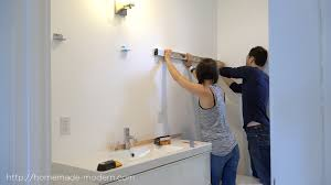 sliding bathroom mirror: this bathroom mirror features diy hardware that slides on plywood shelves full instructions can be