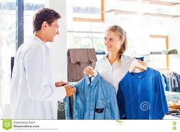 shop assistant at a clothes store stock photo image  shop assistant helping to choose clothes stock photo