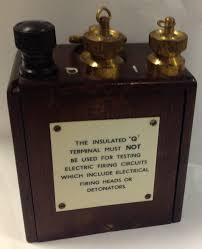 british army blasting galvanometer tales from the supply depot the i and q terminals referred to on this plate are mounted on the top of the instrument a large brass ring image