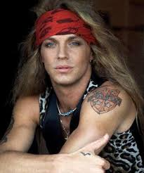Bret Michaels showing his poison tattoo and the tattoo on his hand. - bretmichaels3