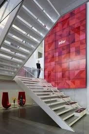 2 stair and media wall 700x1050 infors collaborative new york city headquarters ancestrycom featured office snapshots