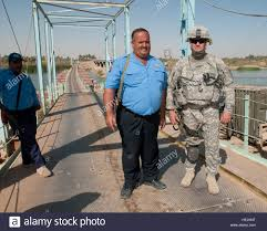 najee hamed a shift supervisor for i police guarding the najee hamed a shift supervisor for i police guarding the saqlawiya bridge and construction on