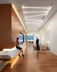 fig 1 the reception area in the cole capital office building combines geometrically placed ambient lighting fixtures
