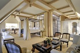 big master bedrooms couch bedroom fireplace: large l shaped master bedroom design with four poster bed beamed ceiling