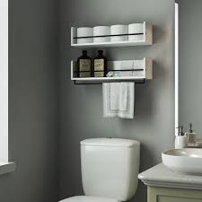 country themed reclaimed wood bathroom storage: beautiful white shelves in the bathroom over the toilet looks stunning with that paint color