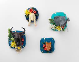 a tale of two cities two young n jewellers make their lisa furno 2015 these trophy heads have funny accents brooches plastic toys pegs