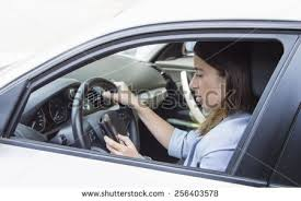businesswoman in the car sending a text work and life concepts business life concepts
