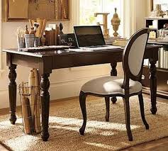 brilliant office design implemented with light brown colored wooden affordable home office desks filled with various wooden sculptres and facing egg back brilliant furniture office chair