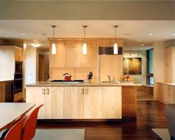 captivating contemporary kitchen with dark wood flooring also blonde kitchen cabinet color also pendant lights and modern blonde kitchen cabinet also small beautiful modern kitchen lighting pendants yellow