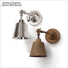 on the spendy side you can get a pair of these barbara cosgrove library wall sconces in either polished nickel or mustard patina on brass for 279 brass swing arm wall