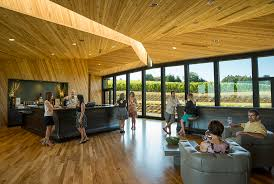 inside the tasting room floor to ceiling windows allow natural light to fill allowing natural light fill