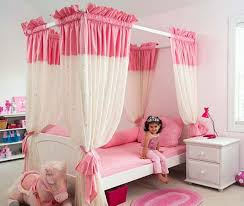 cute pink girl bedroom idea with cute doll decoration and two white drawer chest and white charming kid bedroom design