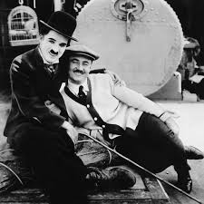 charlie chaplin and his brother sydney chaplin on the set of the thefilmstage charlie chaplin and his brother sydney chaplin edna purviance on the set of the immigrant watch a video essay on social commentary of