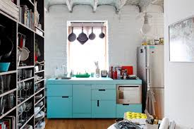 functional mini kitchens small space kitchen unit: this customized and compact kitchen created by designers gut gut packs a lot of storage in minimal space by hanging the pots and pans on the wall you save