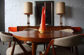 wood extendable dining table walnut modern tables: modern extendable walnut dining table with dark brown painted hidden leaf and round tapered legs over mahogany wood floor as well rusti