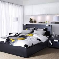 a bedroom with a black brown malm bed best storage with white doors and bedroom furniture photo
