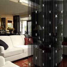 living room dividers ideas attractive: attractive picture of living room decoration using red flower rug in living room along white leather living room triple sofa and black beaded curtain ikea