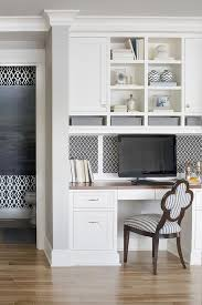kitchen cabinets home office transitional: lovely kitchen features a built in desk with wood top under inset black and white