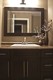 espresso brown shaker style bathroom vanity with a leather look mirror http bathroom recessed lighting ideas espresso