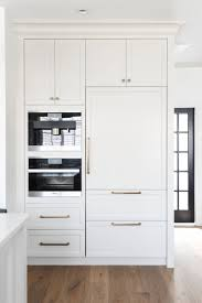kitchen cabinets home office transitional: stunning transitional taupe kitchen with miele wall oven and hidden fridge by chrissy cottrell chrissy