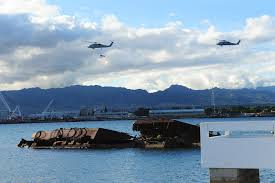 u s department of defense photo essay navy helicopters fly an american flag over the uss utah memorial on pearl harbor hawaii