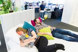 a company has revealed how it has installed a double bed in the middle of the bed office