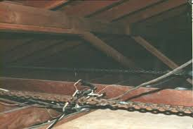 roof repair place: purlin supports were at such a low angle as to give no support the roof was slowly falling down something had to be done and soon