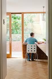 livework office timber oak sliding door and window brick internal wall architects sliding door office