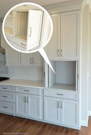 kitchen cabinets ideas min pocket doors in kitchen cabinetry perfect for hiding a tv microwave or