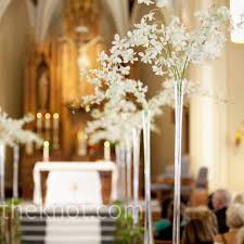 day orchid decor: white orchid ceremony decor white orchids spilled from the top of trumpet vases along the aisle of the church ceremony pinterest the church