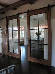 industrial chic barn style sliding doors with rippled glass panes allow privacy but still allow light barn style sliding doors