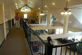 How the Duggars     custom home separates their sons from their    Visible  Jim Bob Duggar strolls over the catwalk  which is attached to stairs leading