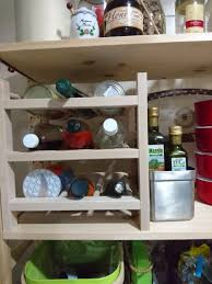stand kitchen dsc: the wine bottle rack from ikea which i used for cans vinegar bottles make sure to keep the neck of the bottle is at  angle just in case it does not