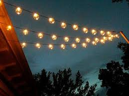 i love this look of lights over the deck she gives directions on how she backyard string lighting ideas