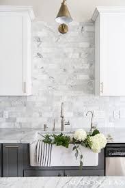 guy kitchen meg: two toned gray and white cabinets marble subway tile carrara countertops a