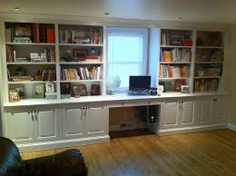 white stained wooden floor to ceiling cabinet bookshelf integrated with computer desk in front of glass adorable office library furniture full size