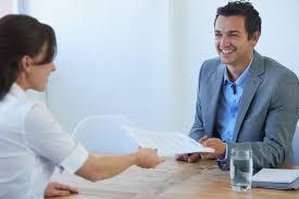 woman handing man her resume
