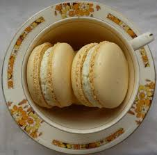 A lemon and orange and <b>Lady Grey tea</b> macaron. <b>Naturally</b> coloured ...